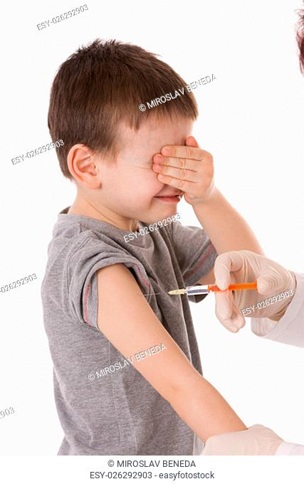 Doctor giving a child injection in arm on isolated image