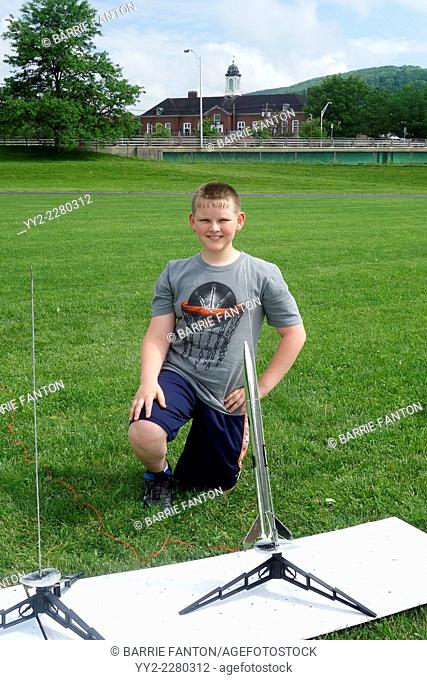 6th Grade Boy Posing With Model Rocket, Wellsville, New York, United States