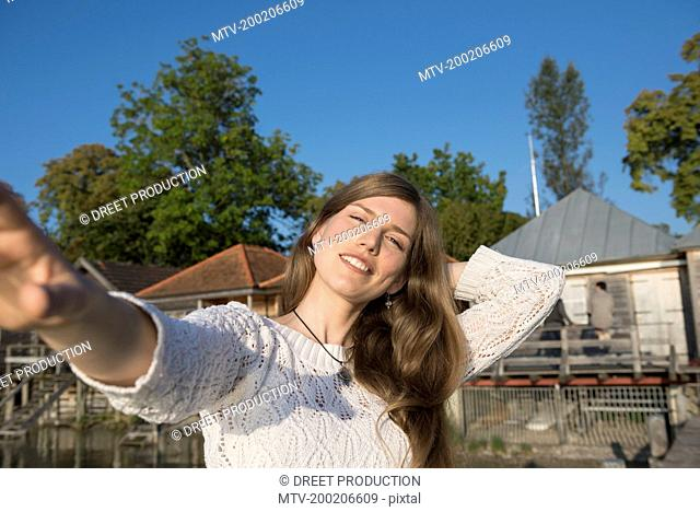 Smiling young woman sunset portrait