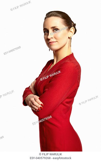 34d1ebfafc1 Portrait of young attractive woman in red dress looking at camera. Isolated  at white background