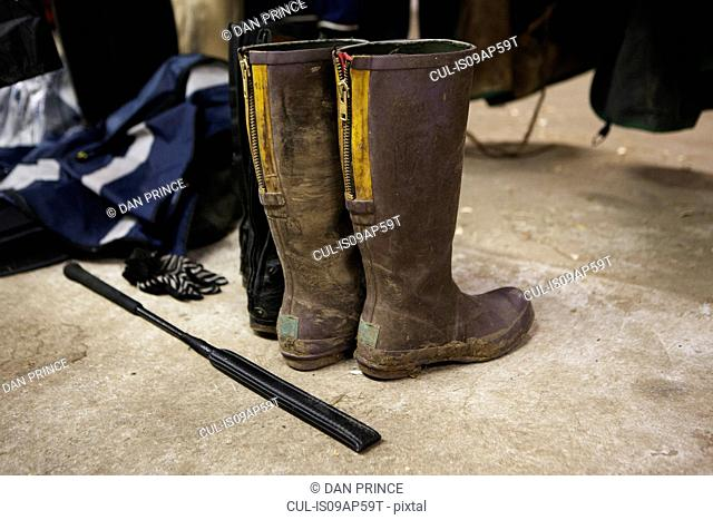 Horse riding boots and crop