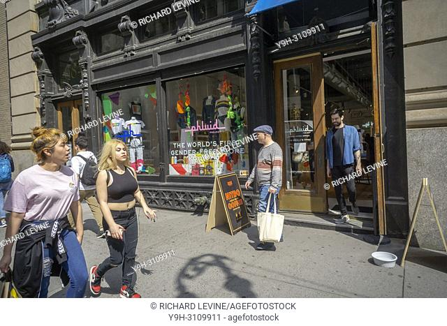 Passer-by in front of The Phluid Project store in Greenwich Village in New York on Thursday, June 7, 2018. The Phluid Project promotes itself as the world's...