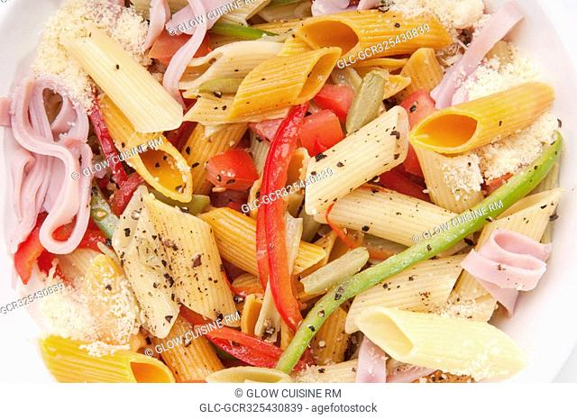 High angle view of a bowl of penne pasta and ham salad