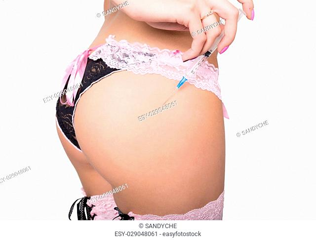 Cosmetic injection in the female buttock. Beauty treatments in the spa salon