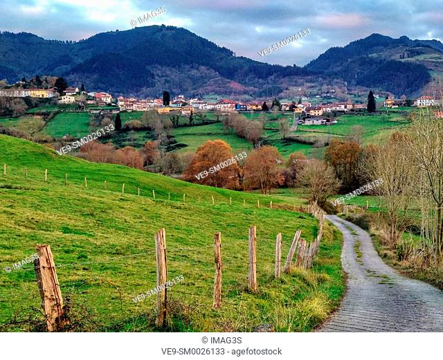 Meadows and rural landscape near Ceceda village, in background, Nava municipality, Asturias, Spain