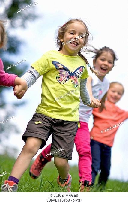 Kindergarten kids running in a wood kindergarten