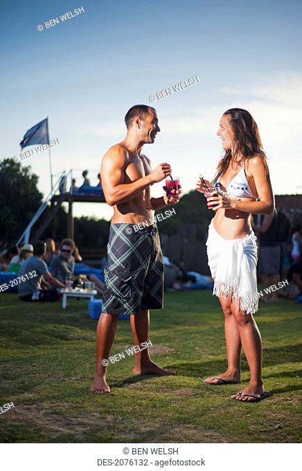 A Young Man And Young Woman Talking At A Beach Bar, Tarifa Cadiz Andalusia Spain
