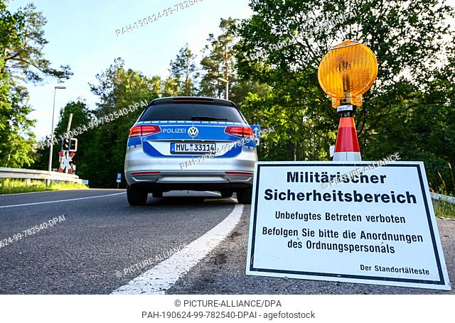 "24 June 2019, Mecklenburg-Western Pomerania, Jabel: On a sign on a closed road it says """"Military security area - Unauthorised entry forbidden - Please follow..."