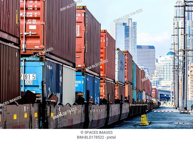 Train carrying containers on train tracks