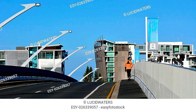 GOLD COAST - OCT 14 2014:Man runs over Ephraim Island bridge.It's a luxury residential development in Gold Coast, Australia