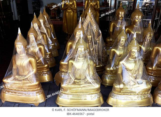 Buddha statues in foil, for sale, devotional business in the Buddha Road, Thanon Bamrung Meuang, Phra Nakhon, Bangkok, Thailand