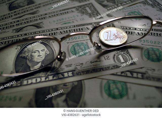 29.04.2014, Unkel, DEU, Germany, one EURO coin on one Dollar bank notes - Unkel, Rhineland-Pala, Germany, 29/04/2014