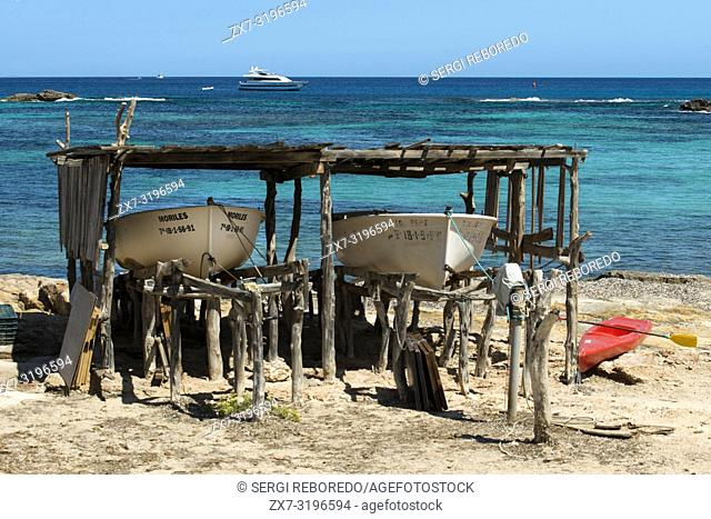 Els Pujols beach in Formentera with traditional fishing boat in summer day. Llaüt