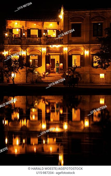 Asia, Vietnam, Hoi An  Hoi An old quarter  View across the Thu Bon river onto the beautiful Bach Dang river promenade with it's romantic Hoa Anh Dao Saigon...