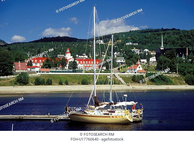 Canada, Tadoussac, Quebec, Sailboats docked at the marina on the St. Lawrence (Fleuve Saint-Laurent) and Saguenay Rivers in the summer resort town of Tadoussac