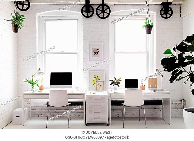 Monochromatic Modern Workplace with Floral Accents