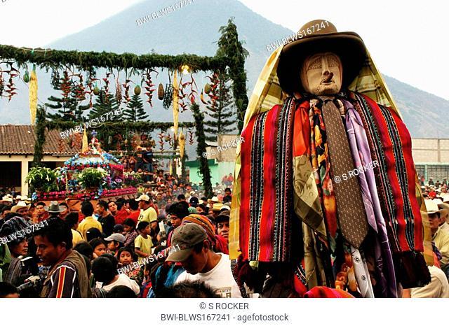Maya patron saint Maximon in procession through Santiago de Atitlan taken, Guatemala, Atitlansee, Santiago de Atitlan