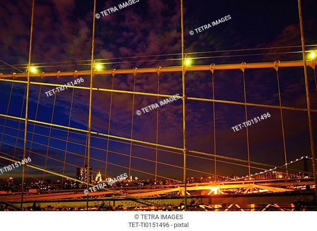 USA, New York State, New York City, Midtown Manhattan and Brooklyn Bridge at night