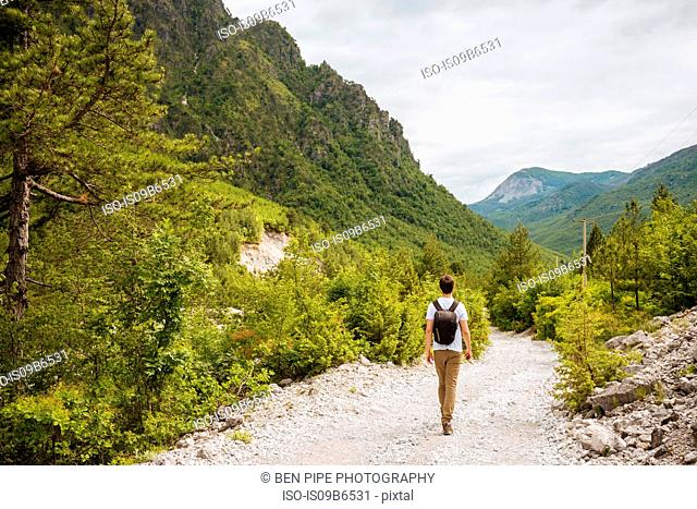 Hiker hiking in Accursed mountains, Theth, Shkoder, Albania, Europe