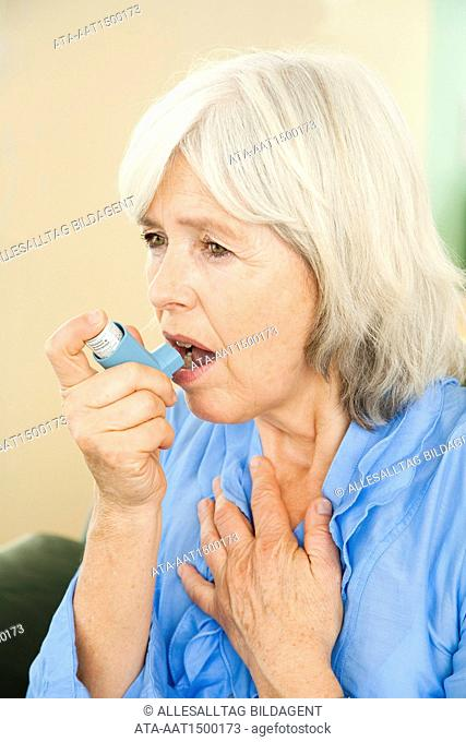 Elderly lady suffering from asthma