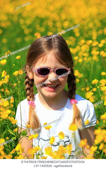 girl standing in blooming field