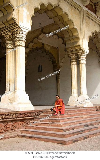 Tourist on steps of Diwan-i-Am, Hall of Public Audience, Agra Fort, also known as Red Fort, Agra, Uttar Pradesh, India