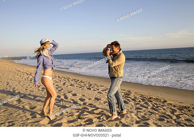 Man Taking Photo of Woman on Beach I