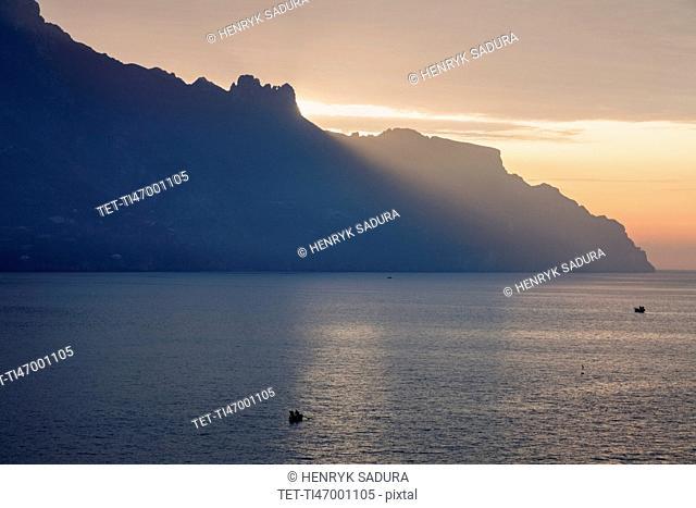 Silhouette of coastline at sunrise