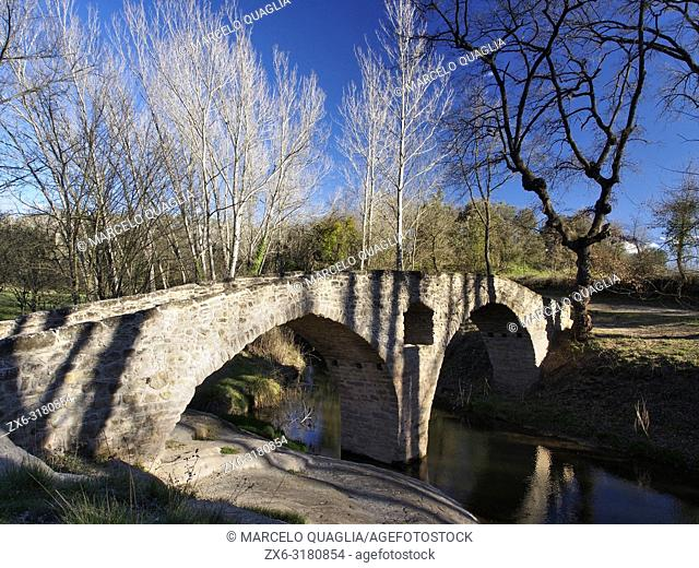 Romanesque bridge over Gavarresa stream. Sant Martí d'Albars village neighborhood. Lluçanès region, Barcelona province, Catalonia, Spain