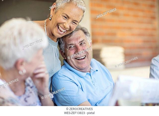 Portait of smiling senior man having fun with his friends