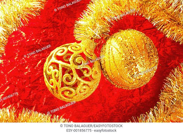 Christmas card golden bauble arabesque and tinsel on red background