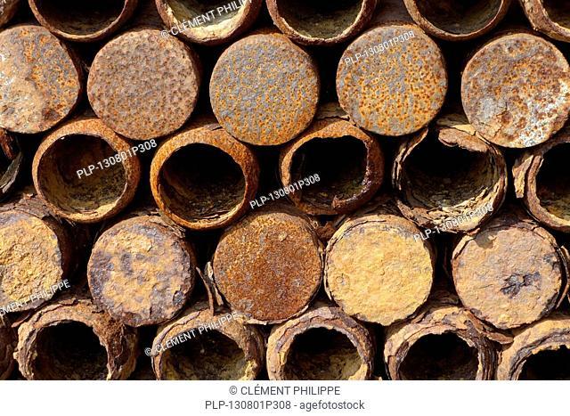 Stacked rusty First World War One artillery grenade shells, West Flanders, Belgium