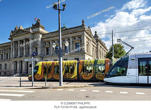Two trams in front of the National and University Library / Bibliothèque nationale et universitaire / BNU at the Place de la République square in Strasbourg