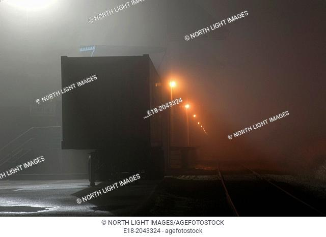 Canada, BC, Delta. Truck depot on foggy night