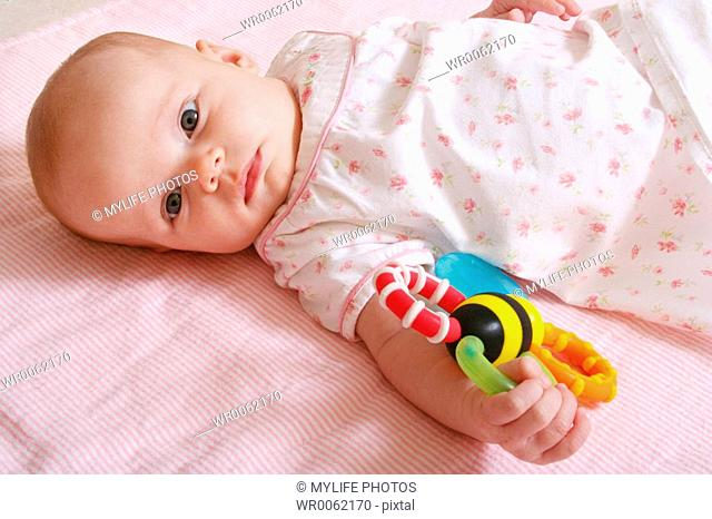 baby with rattle