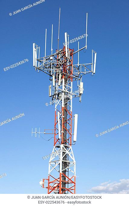 Mobile phone Telecommunication Radio antenna Tower over blue sky