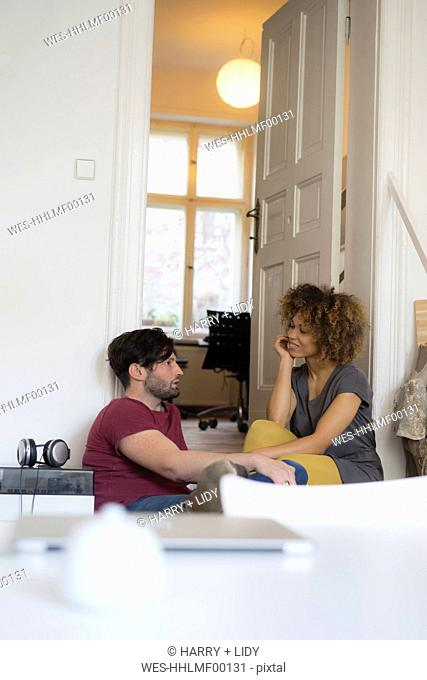 Young couple at home relaxing and talking