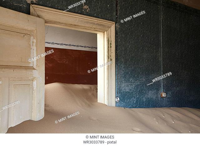 Interior of an abandoned building full of sand