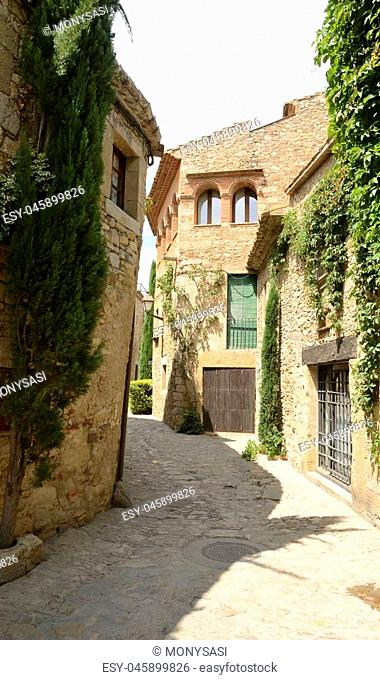 Stone street in the medieval village of Peratallada, located in the middle of the Emporda region of Girona, Catalonia, Spain