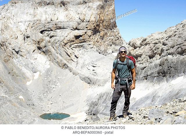 Portrait with front view of mid adult male backpacker during climb of Monte Perdido in Pyrenees, Ordesa y Monte Perdido National Park, Huesca, Aragon, Spain