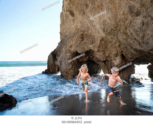 Brothers playing on El Matador Beach, Malibu, USA