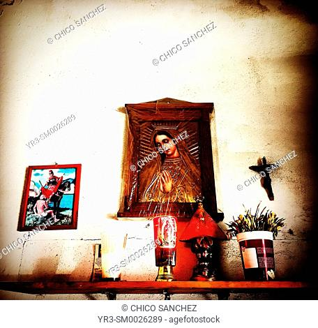 An altar to Our Lady of Guadalupe decorates Guadalupe Bakery in Cholula, Puebla, Mexico