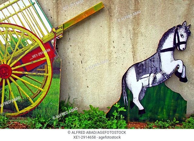 Cart and cardboard horse