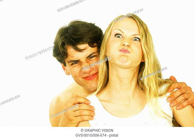 Portrait of young couple making face