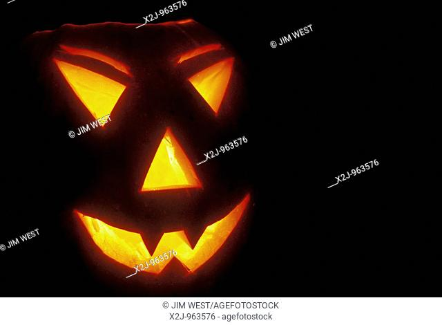 A pumpkin carved into a jack-'o-lantern for haloween