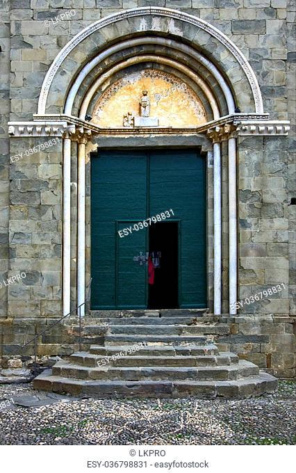 the green yellow gate in the old church of corniglia italy