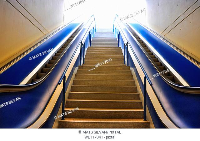 Blue escalators with stairs