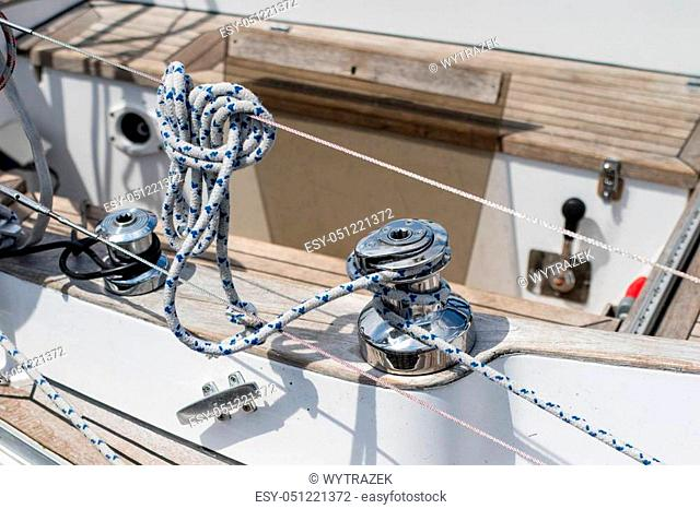 Rigging of deep-sea sailboats. Sailing accessories on a yacht. Season of the summer