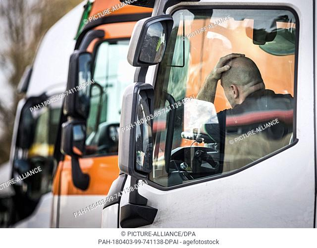 03 April 2018, Germany, Rodgau-Weiskirchen: A truck driver completes his instructed pause in the service station Weiskirchen next to the A3 highway