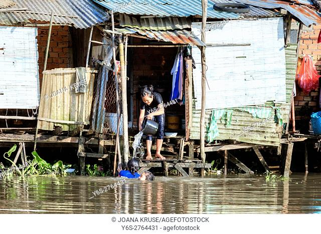 a family washing their hair in the waterways of the Mekong Delta, Can Tho, Vietnam, Asia